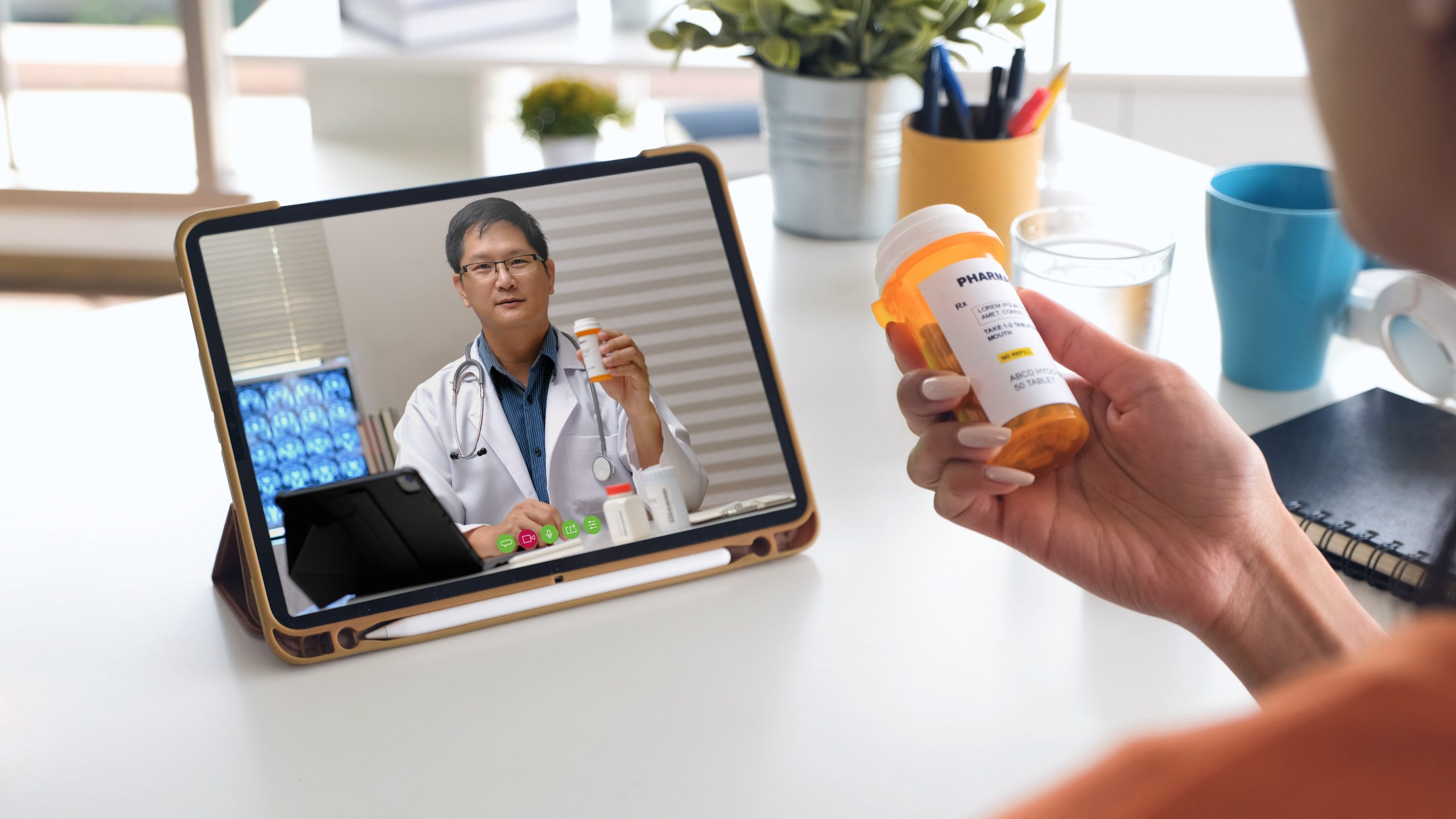 telehealth concept,asian woman video call with her doctor about prescription while staying at home. Close up of patient about illness in video conferencing with general practitioner on digital tablet.